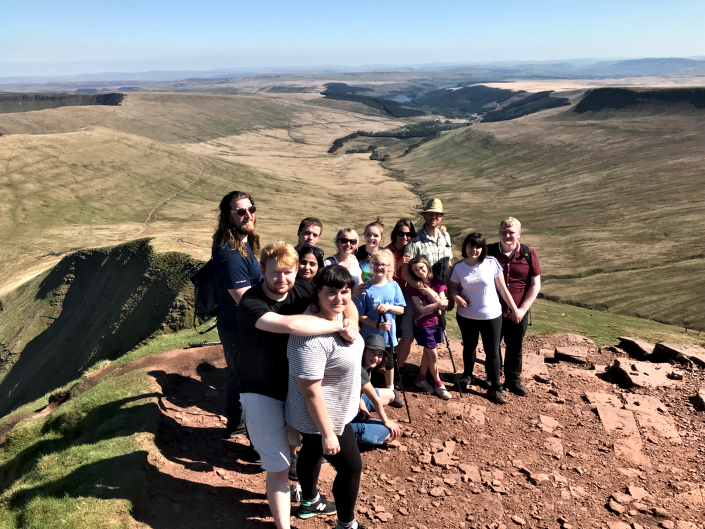 Some of the Intersys team and families atop the summit of Pen Y Fan in Wales