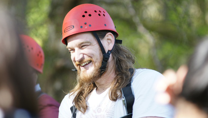 Close up of Intersys Professional Services Director Mark Kirby smiling and wearing hard hat at company team building event