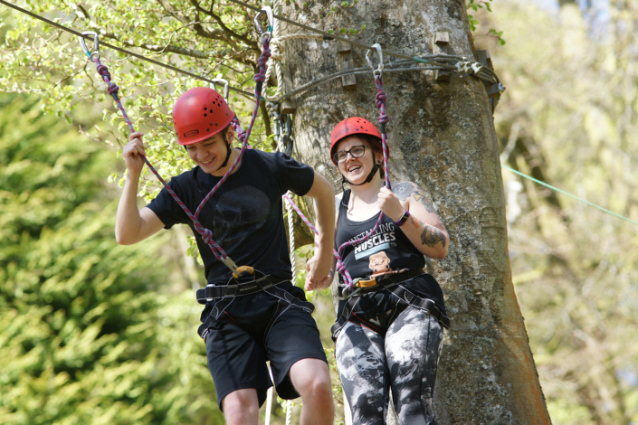 Intersys IT Support Engineer Yaccer, being helped by Shannon on the high ropes