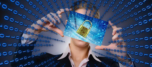 a man holding icon of a lock cover his face and surrounded by binary matrix