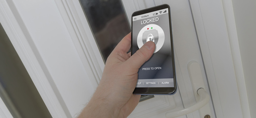 Close up of smart phone being used to lock house door