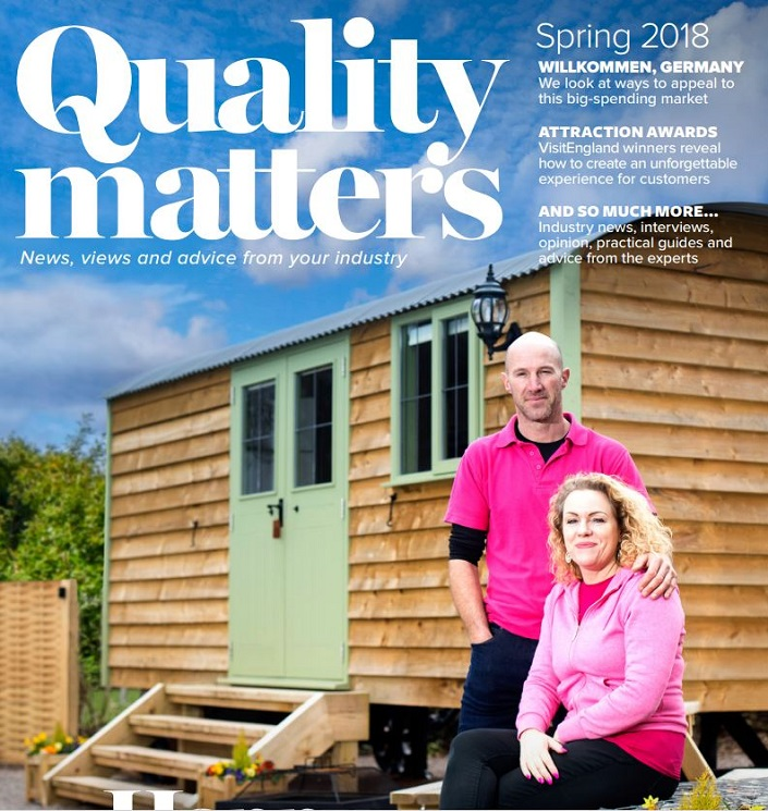 cover of Quality Matters magazine spring edition 2018 showing a couple in pink ops against the backdrop of their caravan park business