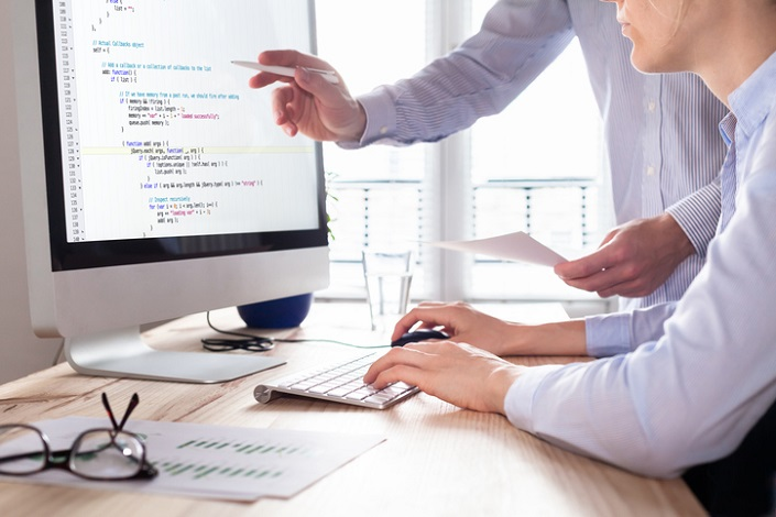 IT Apprenticeship concept for Intresys - team of web app developers coding website source code