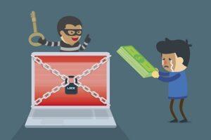 NHS Wannacry: a cartoon thief locks up a computer and a user tries to hand him money.
